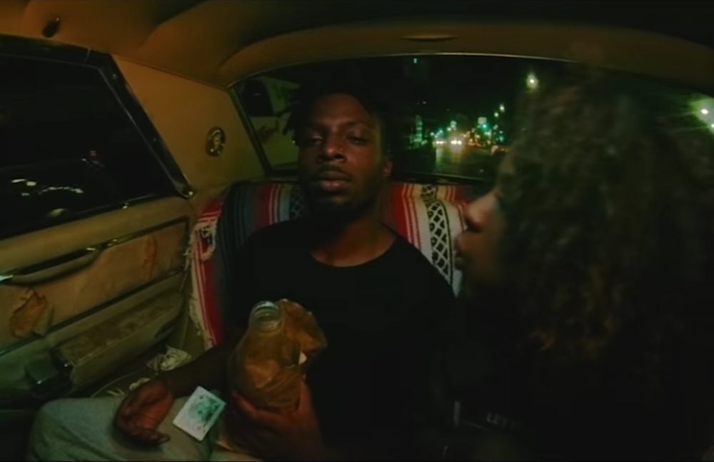 Watch isaiah rashad cruise in new video for park sidewalk hustle isaiah rashad shares park video thecheapjerseys Image collections