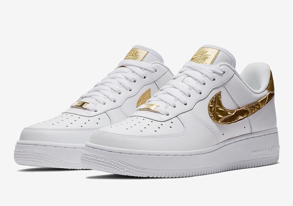 free shipping a2c14 5063e Paying homage to one of the worlds most celebrated athletes, the Nike Air  Force 1 Low CR7 Golden Patchwork features gold accents on ...